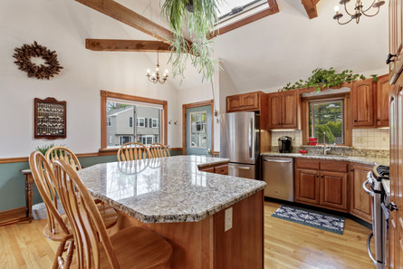 kitchen with island and skylights
