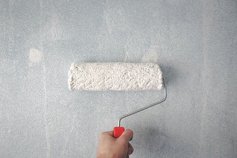 paint roller with white paint on it