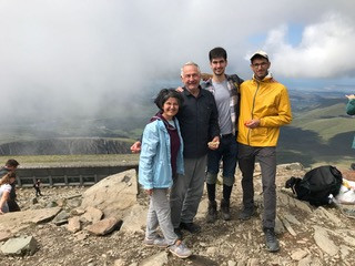 Tanyeli and her family on a mountaintop