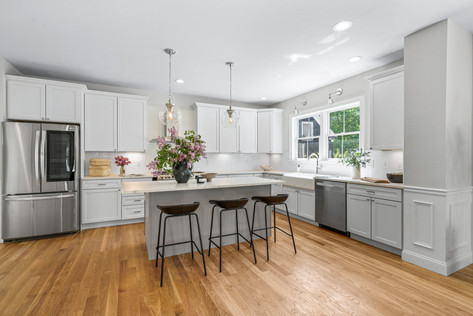 Kitchen with gray and white cabinets and island