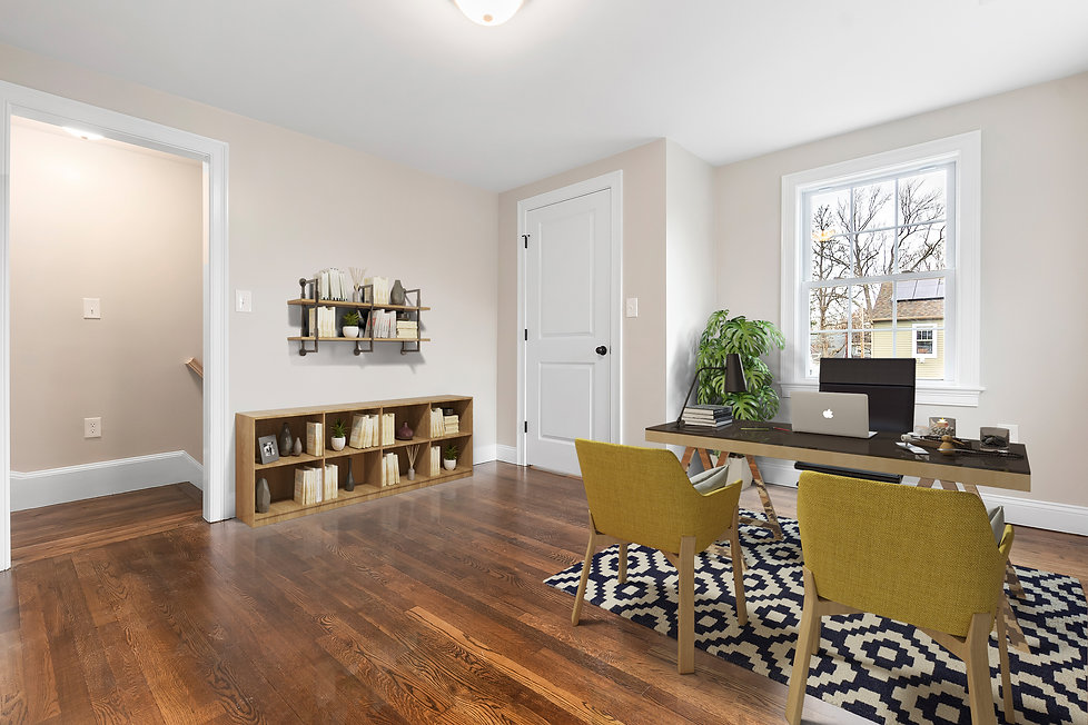 Office with yellow accent chairs and decoative shelves