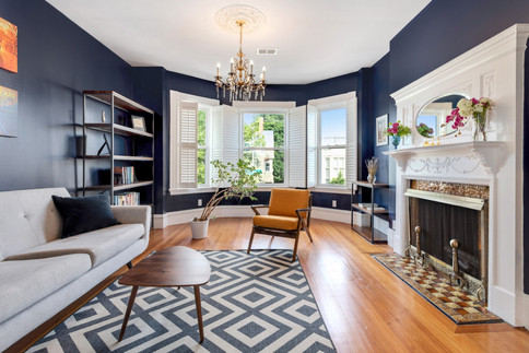 Den with navy walls and fireplace