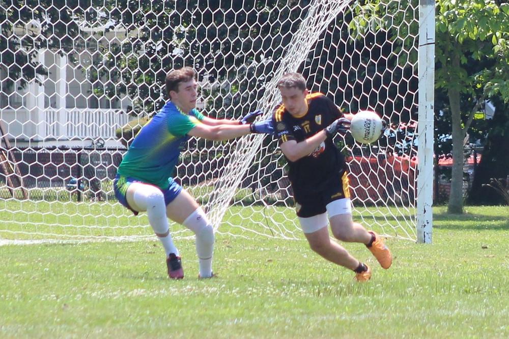 Chris Poggi makes a move past his defender