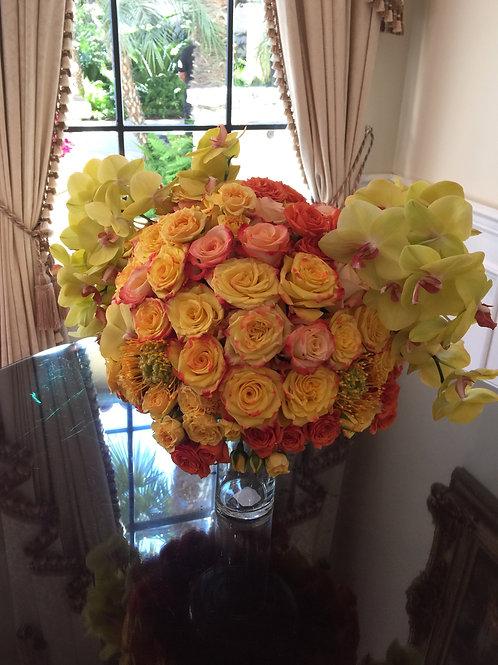 Sunshine Blast - Orchids, Roses Spray Roses and Portea Banksia