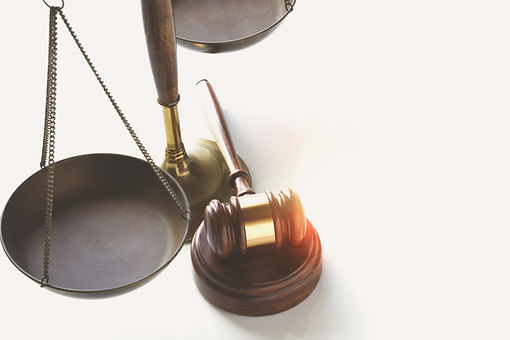 Scales of justice, and wooden gavel. Balancing the law.