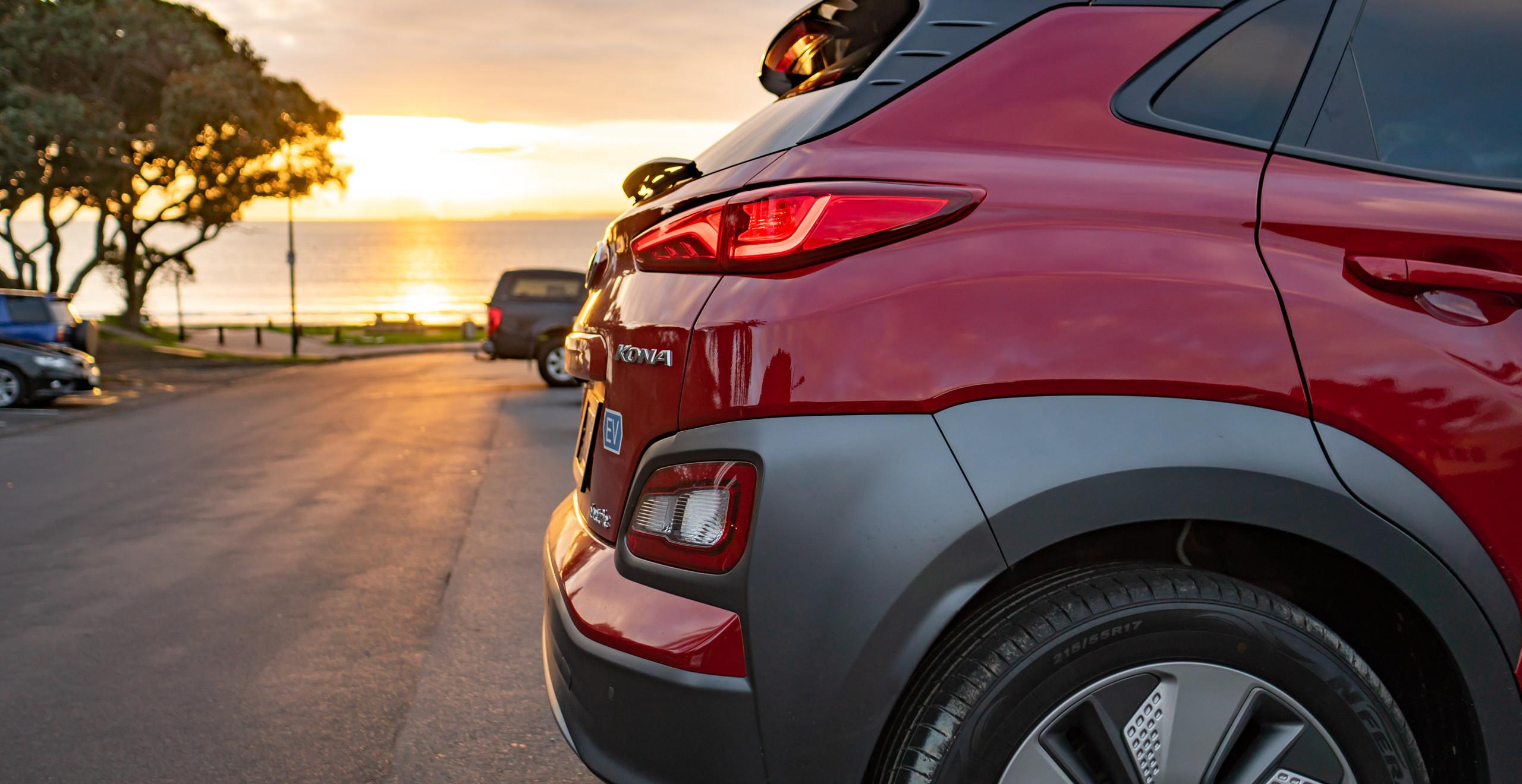Hyundai Kona Electric rear end red sunrise
