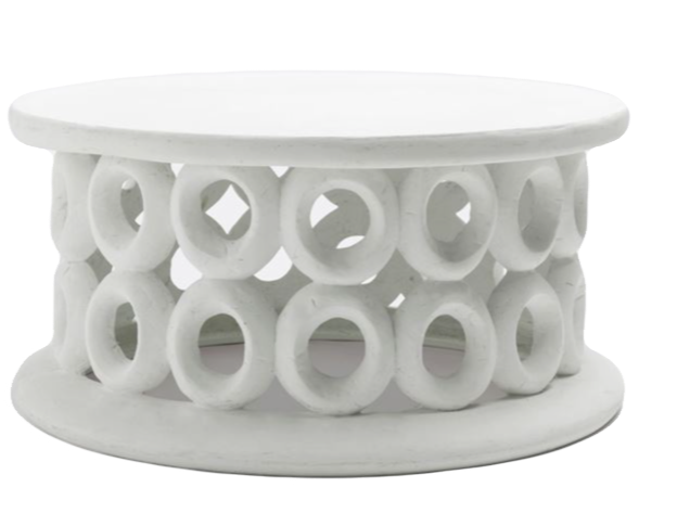 weather-resistant white concrete coffee table with donut holes from Made Goods