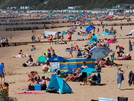 Brits pack beaches and cause railway 'chaos' - despite pleas from police.