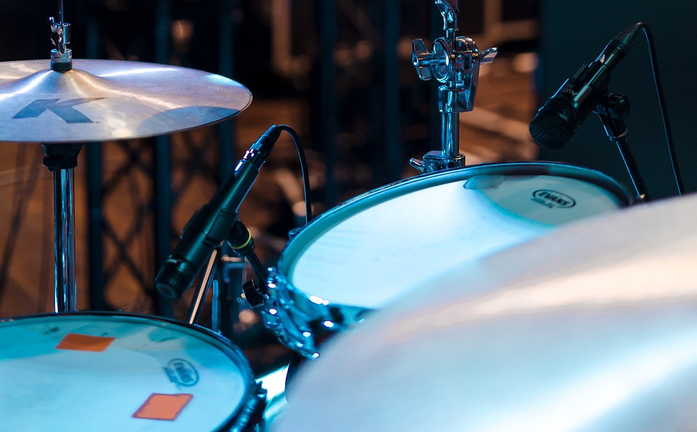 Drum set being miked up with a Shure SM57 microphone