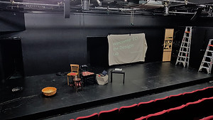 Circa 2 under working lights ready for the Design Lab MAR 2019, with projection saying 'Welcome' and a cluster of assorted chairs.