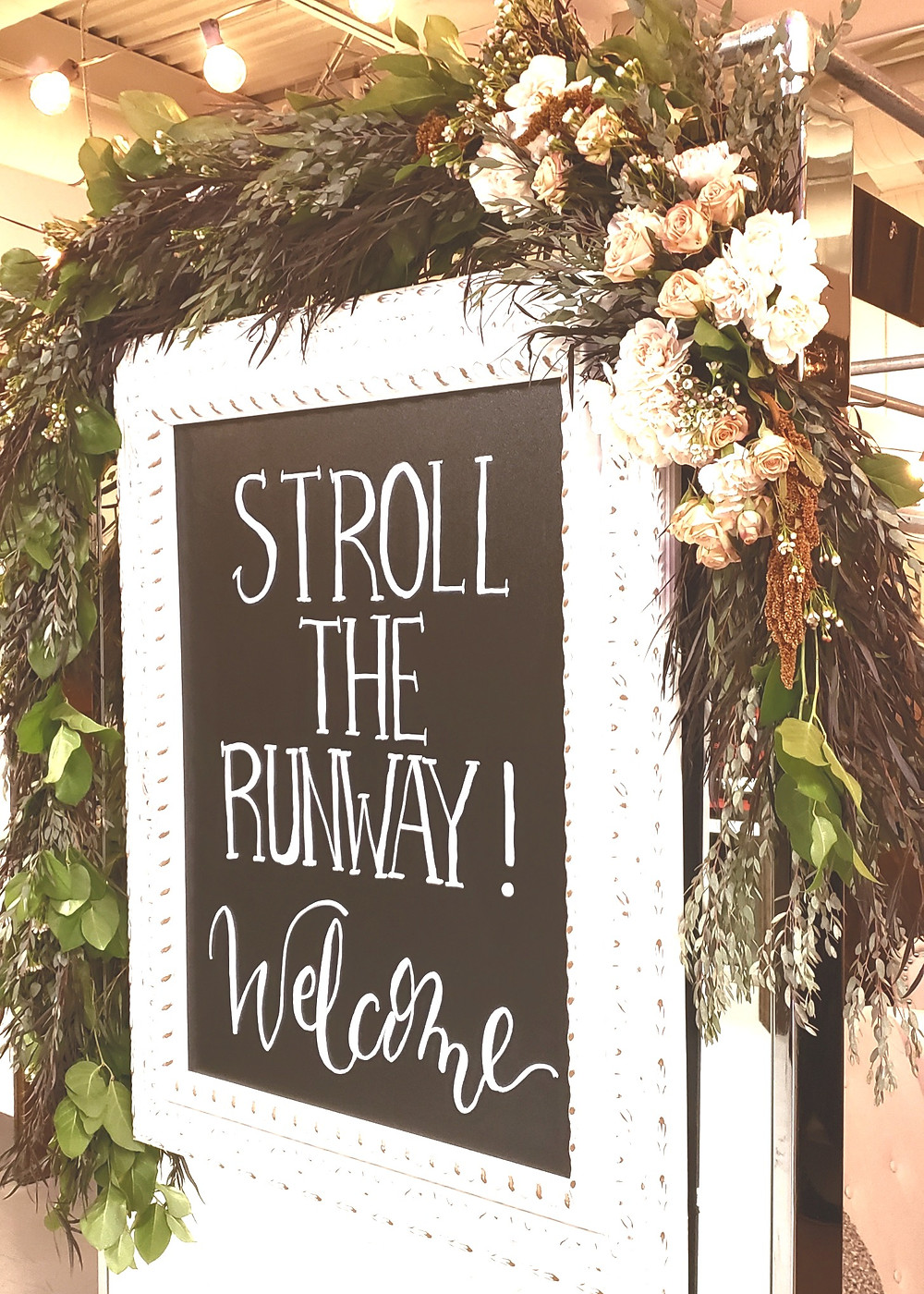 Greenery Garland with floral accents.