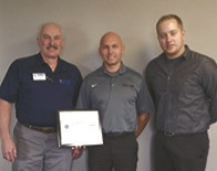 Photo (L2R): Jerry Clusen, ESGR area chair; Erik Larson, President of ECM Holding Group; Staff Sgt. Kenton Craddock