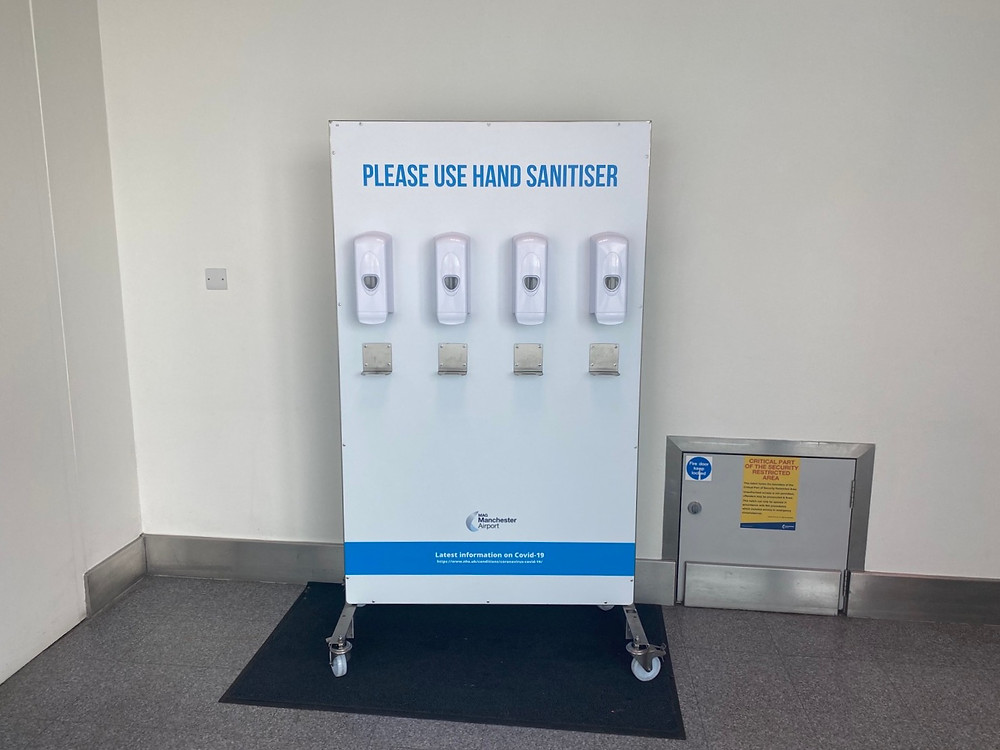 Sanitiser station inside terminal 3 at Manchester Airport