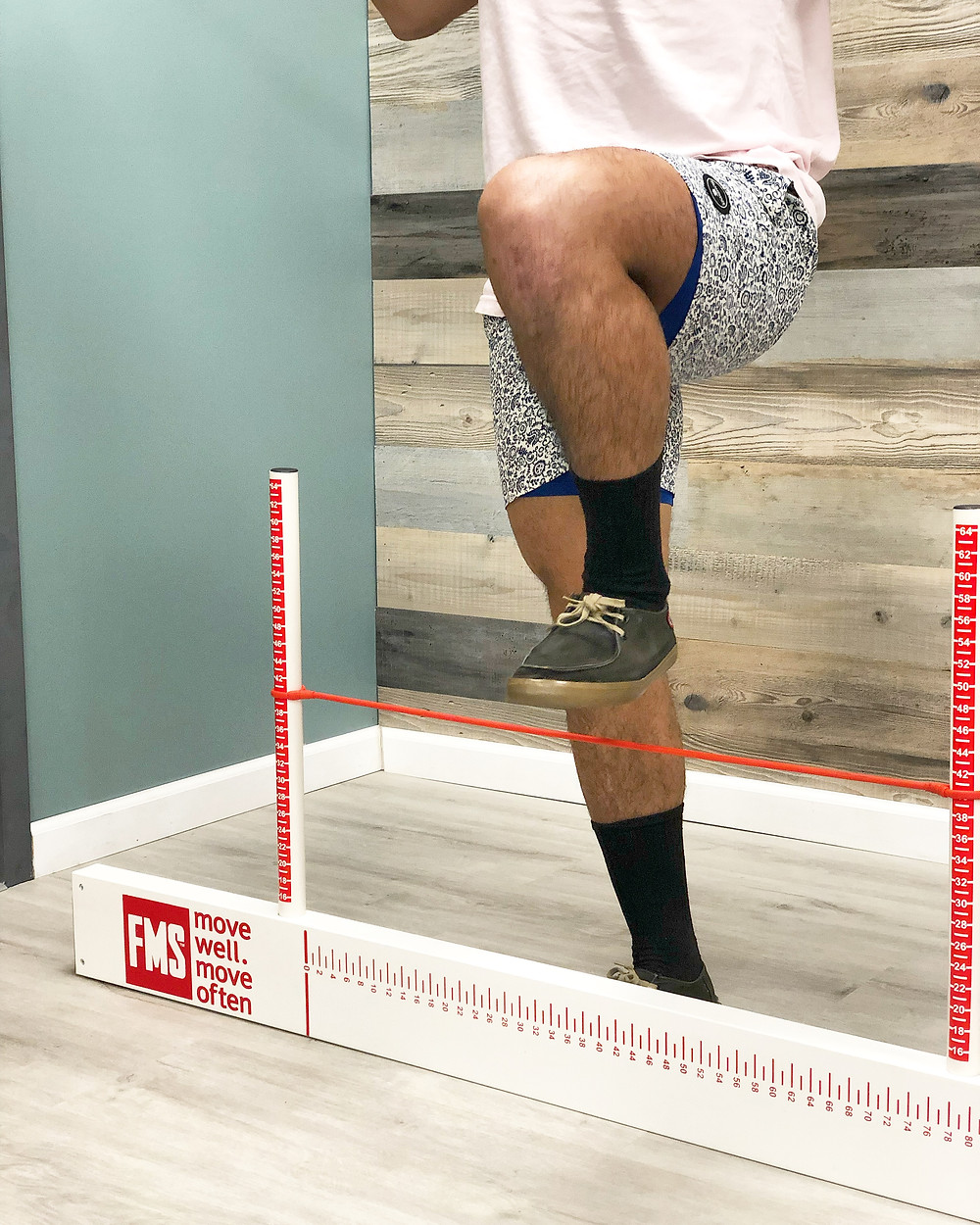This athlete is performing the Hurdle Step movement of the FMS