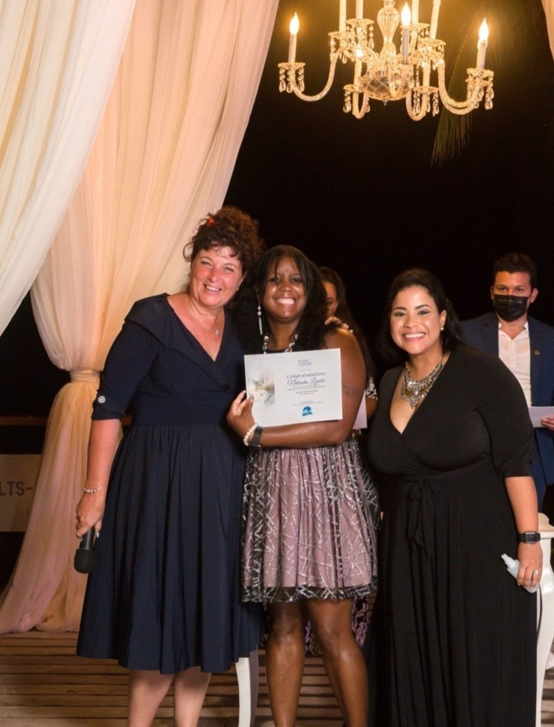 Kiesha Lizaire accepting award at ceremony