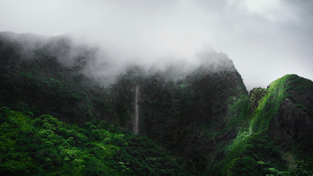 Waterfall in the clouds of Maui's Iao Valley, Hawaii