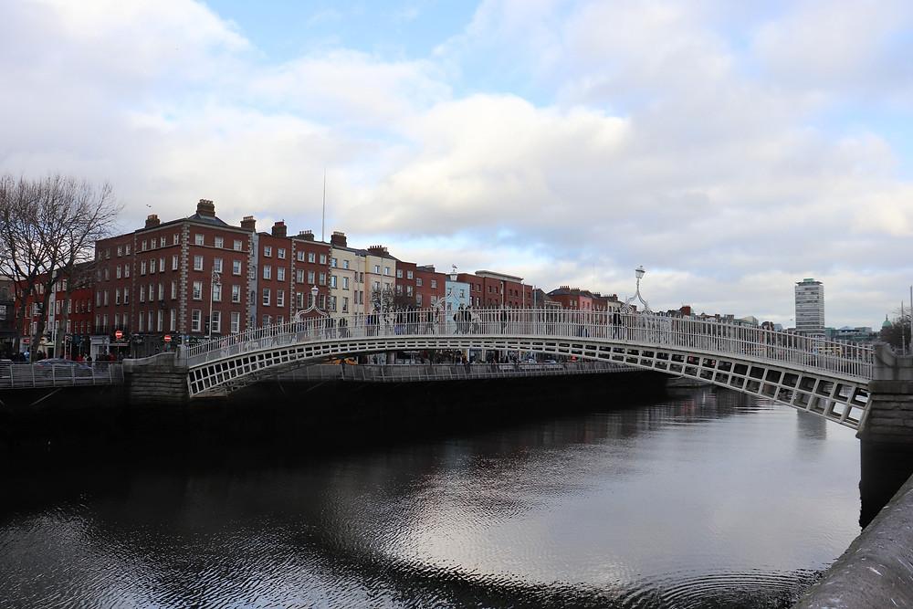 Ha'penny Bridge crossing the river in Dublin Ireland