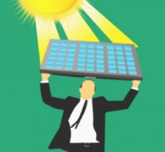 Man holding solar panels up to the sun