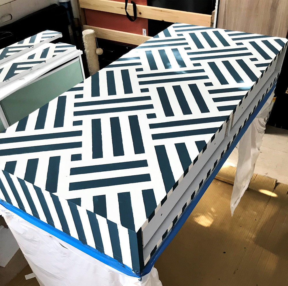 hand-painted desk with blue and white striped pattern chalk paint