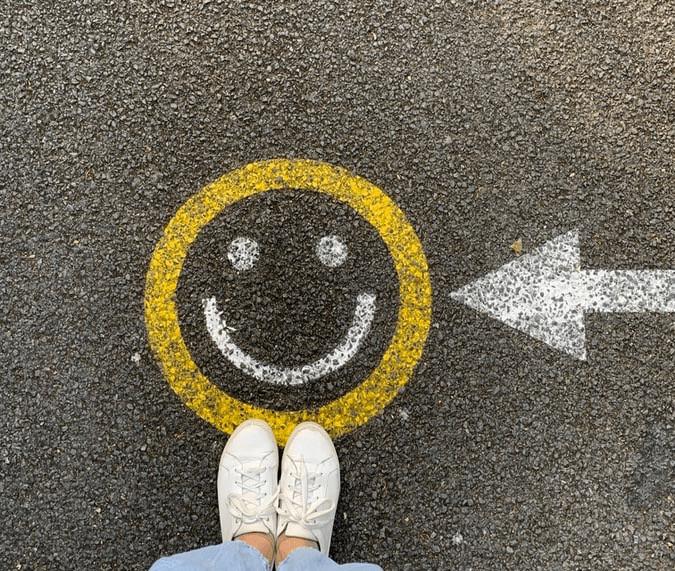 A smiley face drawn on concrete.