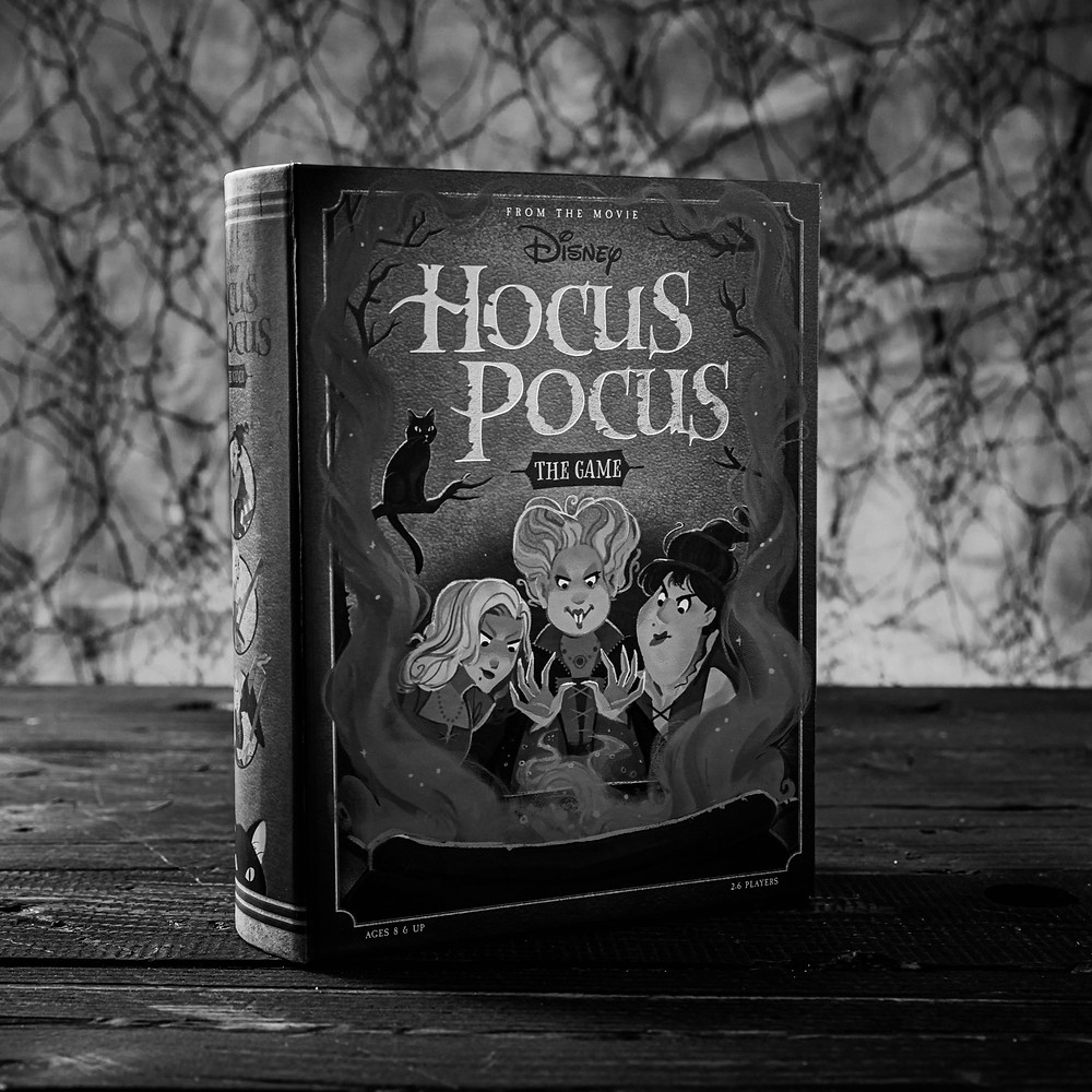Hocus Pocus Board Game with spider webs in the background