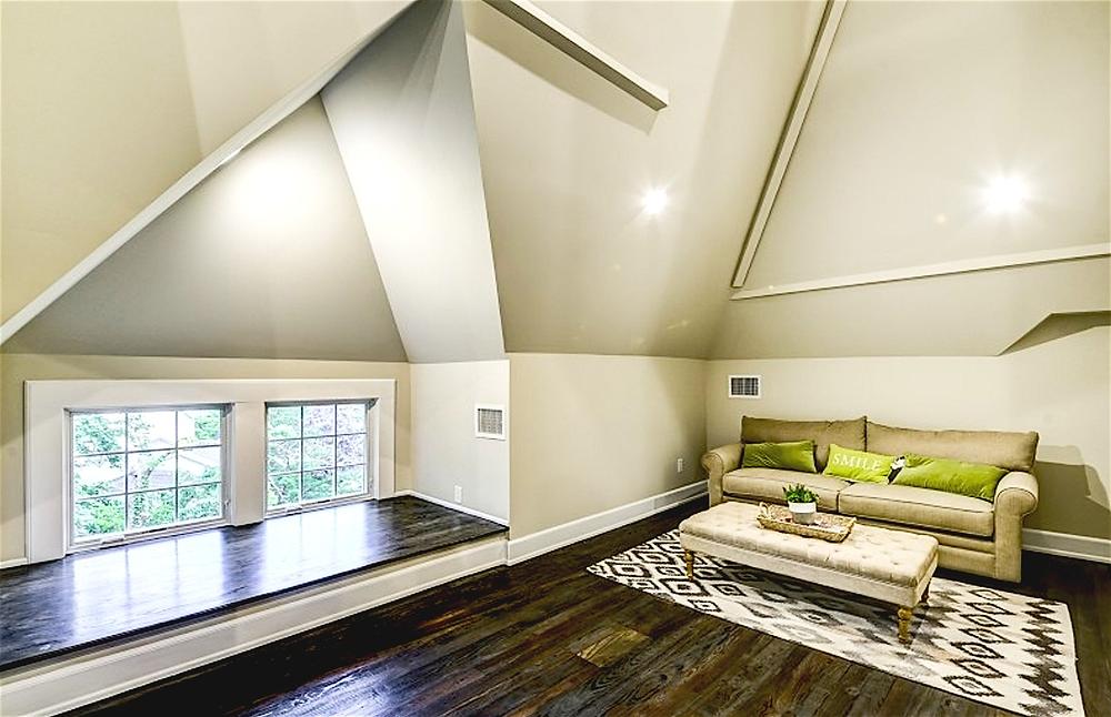 Vaulted ceiling with multiple angles, dark hardwood floors