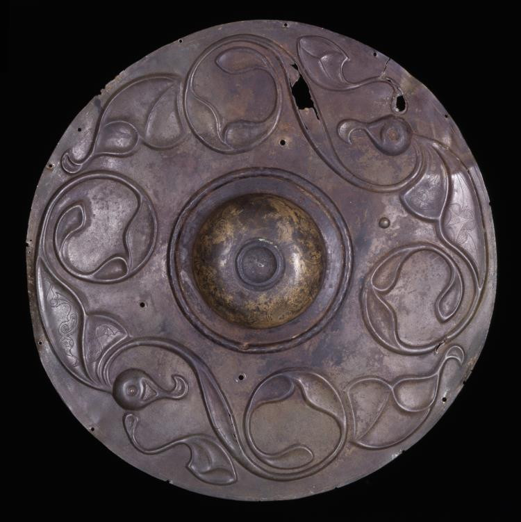 A bronze shield boss with intricate designs