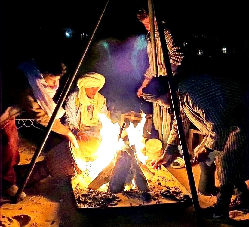 musical night around a campfire at Sahara desert in morocco