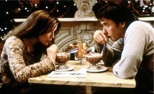 woman-and-man-sipping-frozen-chocolates-in-out-of-straws-at-Serendipity-Cafe-in-New-York-City