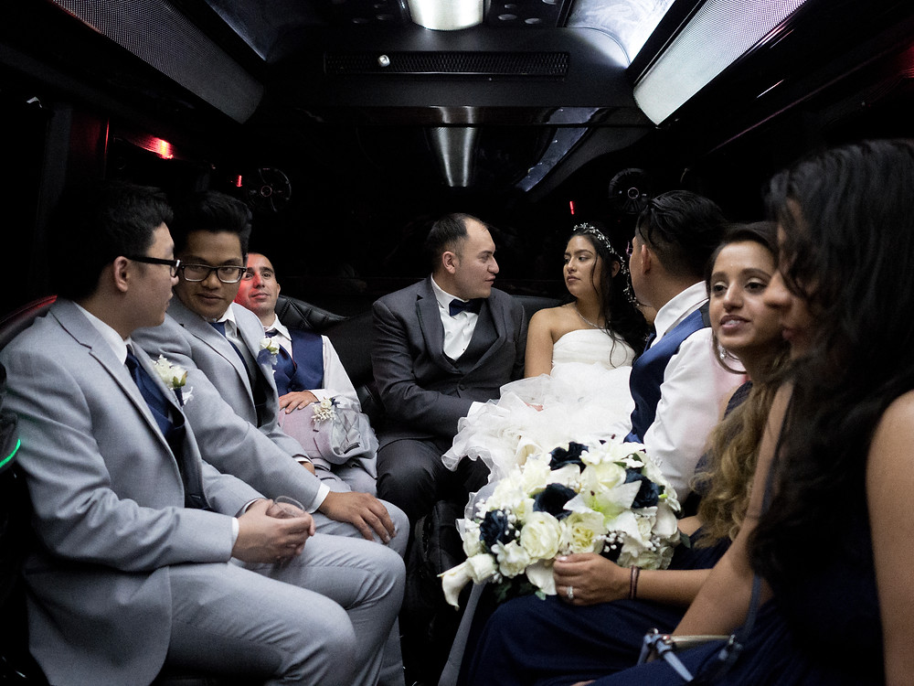Wedding party on the bus after the wedding