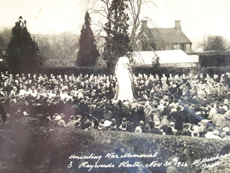 A blind ex service man was guided by his wife up the mound to lay a laurel wreath...