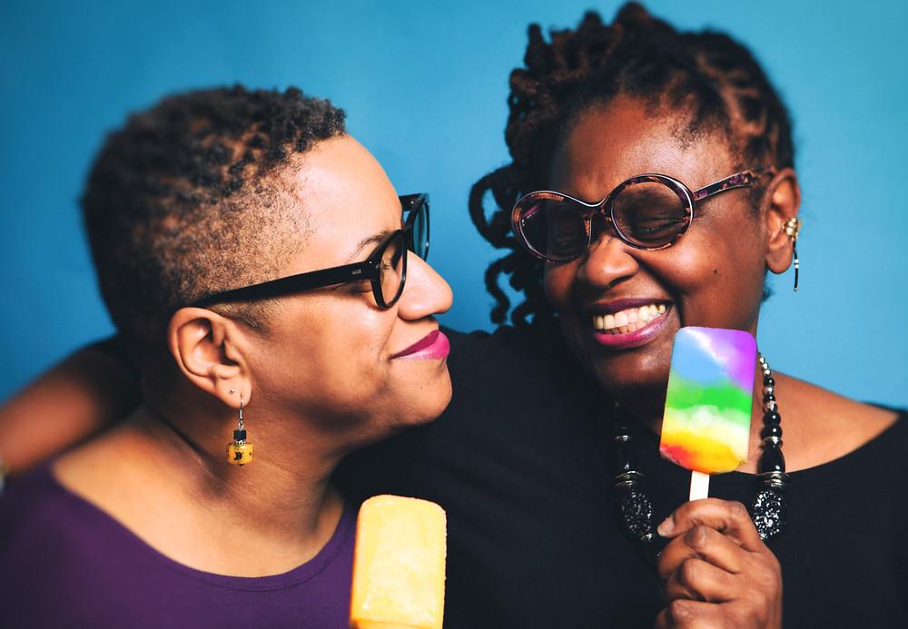 Lesbian-couple-connecting-eating-ice-cream.jpg