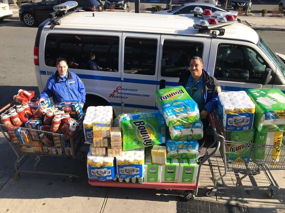 NYPD police officers delivering household goods and food to families