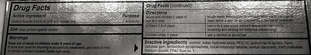 """The """"Drug Facts"""" label with the ingredients of a popular mainstream brand of toothpaste."""
