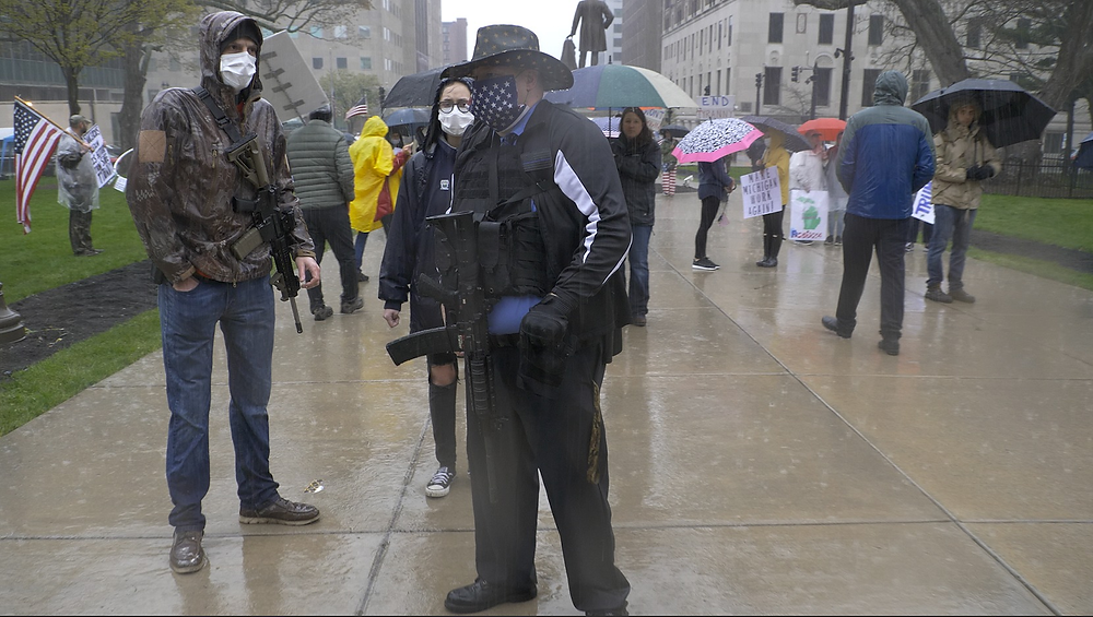 Two men with AR-15's in front of the state capitol building in Lansing, Michigan.
