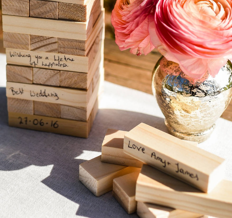 Wooden pieces of the game Jenga, signed by wedding guests