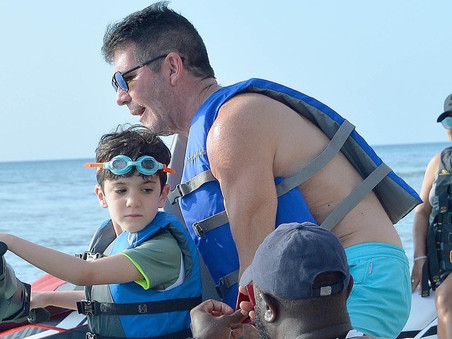 Simon Cowell continues his Barbados holiday with Lauren and Eric