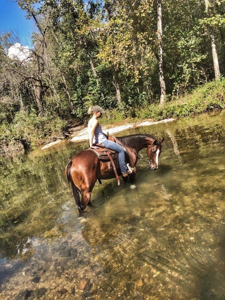 Ashely Massengale training racehorses on the trails. Beyond the Rail.