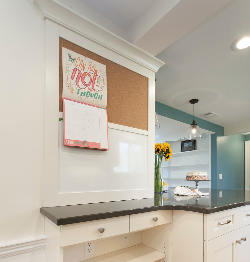Cork board in white kitchen with calendar