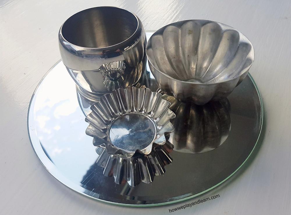 silver, shiny, loose parts play