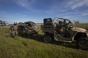 """Source: DVIDS, """"U.S. Marines Use Polaris RZR to Transport Gear at Pacific Blitz 19 by LCpl Tia Carr,"""" accessed 15 May 2019, https:// www.dvidshub.net/image/5227981/us-marines-use-polaris-rzr-transport-gear-pacific-blitz-19."""