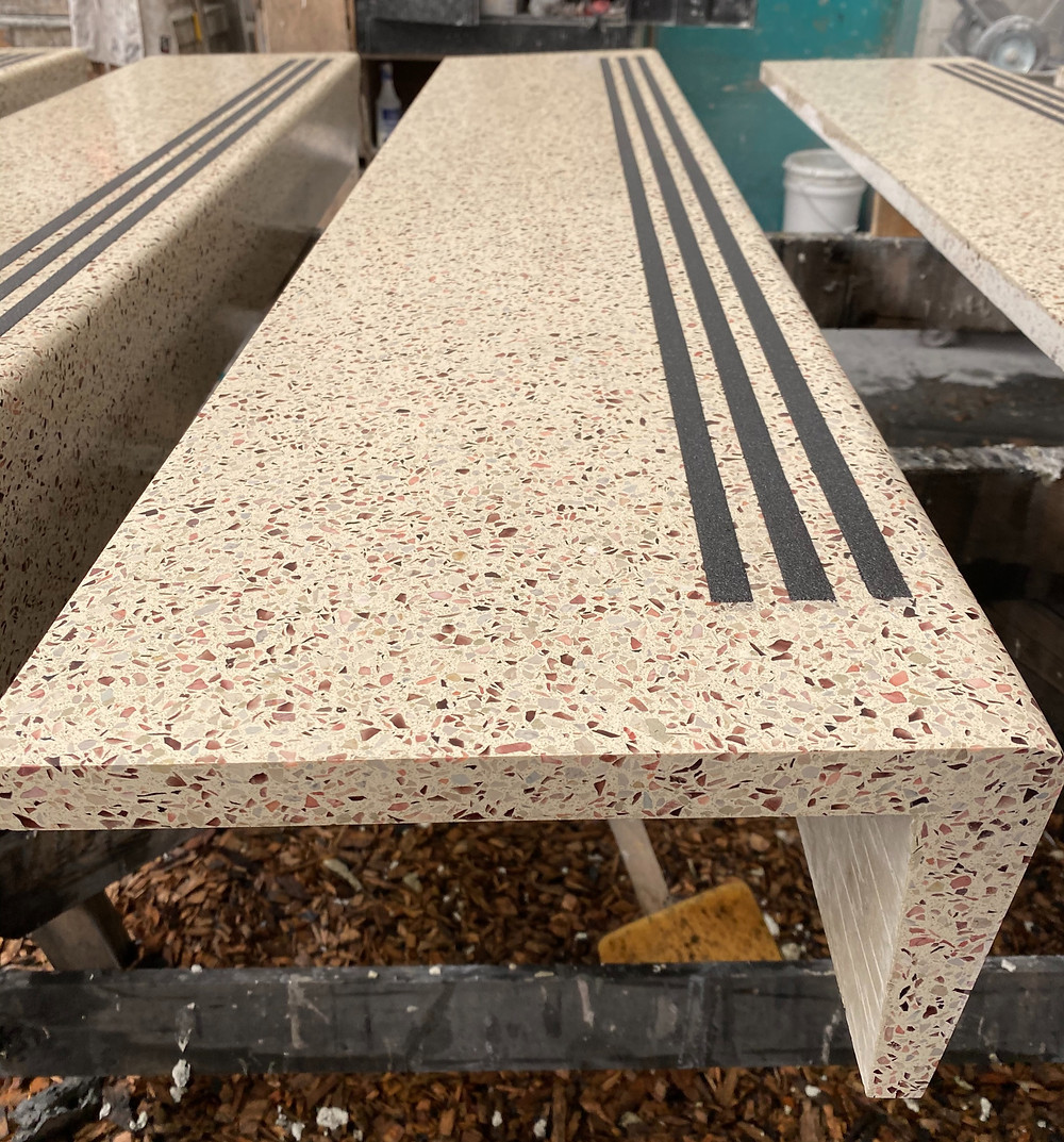 Precast epoxy terrazzo stair tread and riser with cast in nosting
