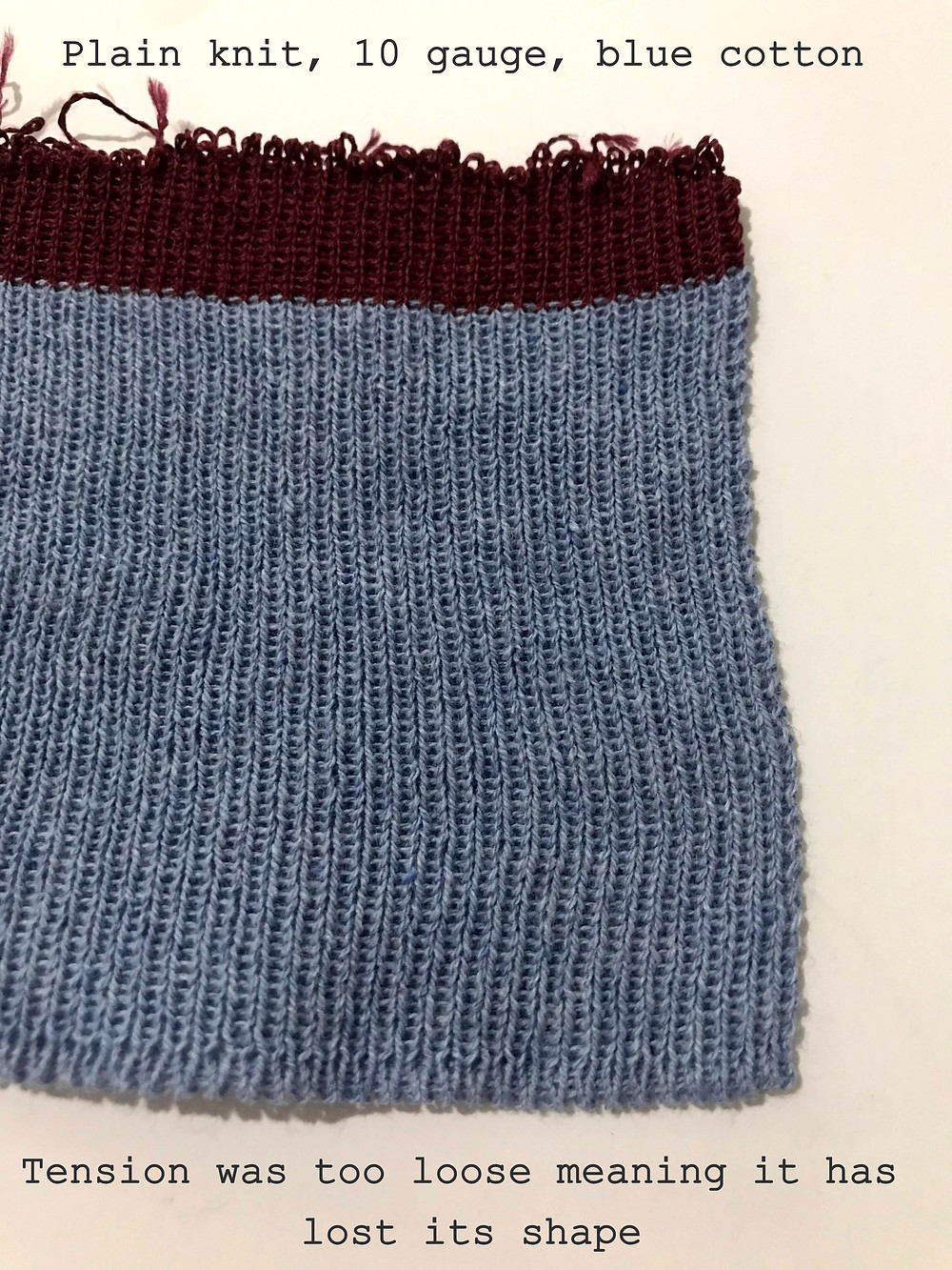 Blue cotton, plain knit, 10 gauge. I think my tension was too loose which caused it to loose its shape.