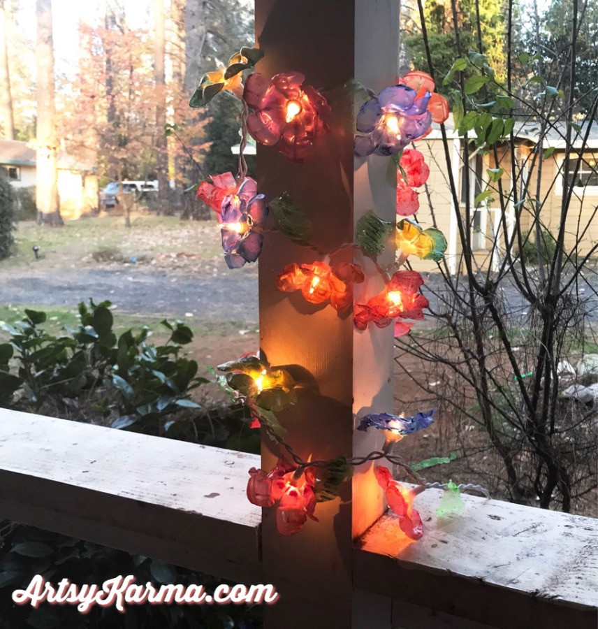 recycled plastic glued to string of lights