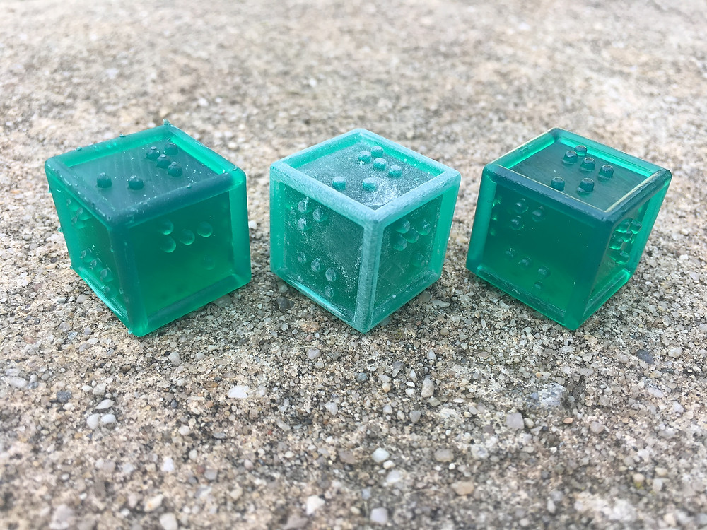 3 d6 in different stages - cured with supports freshly cut, sanded, and after gloss paint.