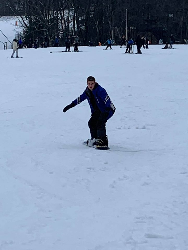 My son like to snowboard to overcome cabin fever