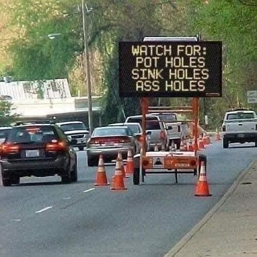 Watch for Pot Holes Sink Holes Ass Holes Sign