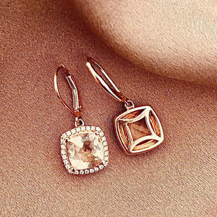 square cushion cut morganite pair of drop earrings with diamond halo and open back filigree on rose gold silk background by Tsarina Gems