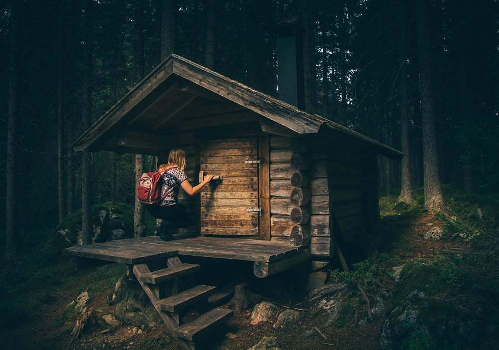 Woman looking in a hidden cabin.