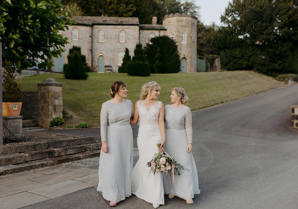 bride with bridesmaids outdoor wedding